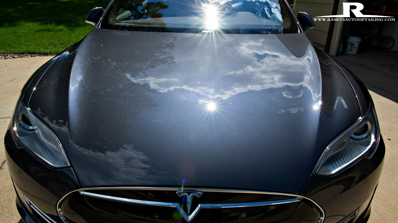 Rasky's Auto Detailing Minneapolis - This Tesla has a glossy aura